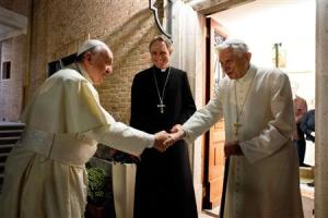 Pope Francis shakes hands with Pope Emeritus Benedict XVI at the Mater Ecclesiae monastery at the Vatican