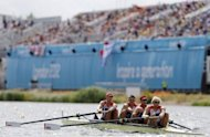 "Great Britain's rowers are seen at heats for the London 2012 Olympics on July 30. Organisers aimed to quell concerns over empty seats by making thousands of tickets available Monday. Some 3,000 tickets from international sports federations were ""put back in the pot"" and sold to the public Sunday, LOCOG said amid growing public anger"