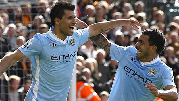 Sergio Aguero and Carlos Tevez of Manchester City (Reuters)