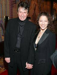 FILE - In this Thursday, Feb. 24, 2005 file photo, comedian David Brenner and Olympic ice skater Tai Babilonia walk the red carpet during the opening night of Barry Manilow's new Las Vegas show at the Las Vegas Hilton. On Saturday, March 15, 2014, publicist Jeff Abraham announced Brenner had died at the age of 78. (AP Photo/Eric Jamison)