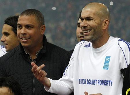 "UNDP Goodwill ambassador Zidane of France gestures next to Brazilian Ronaldo before the eighth ""Match Against Poverty"" soccer match in Piraeus"