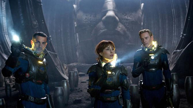"This film image released by 20th Century Fox shows Logan Marshall-Green, left, Noomi Rapace, and Michael Fassbender, right, in a scene from ""Prometheus."" (AP Photo/20th Century Fox, Kerry Brown)"