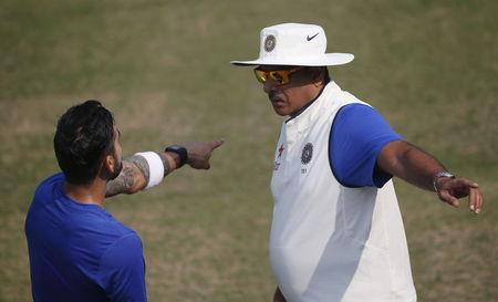India's captain Kohli talks to his team director Shastri during a practice session in Mohali