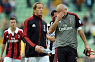 AC Milan's goalkeeper Christian Abbiati (R) reacts next to AC Milan's midfielder and captain Massimo Ambrosini (2nd L) at the end of their Serie A football match against Udinese at the Friuli stadium in Udine. Udinese won 2-1