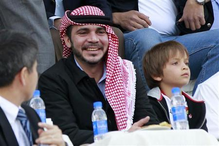 Jordan's Prince Ali bin Al-Hussein and Prince Hashem, son of his brother King Abdullah, watch Jordan play against Japan during their 2014 World Cup qualifying soccer match in Amman