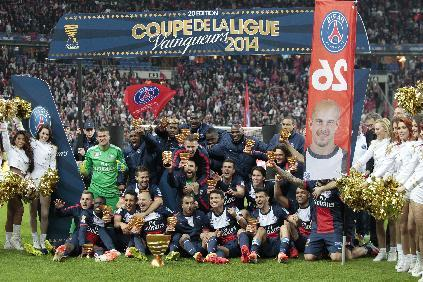 Paris Saint Germain team members celebrate winning their  French League Cup final soccer match against Lyon at the Stade de France in Saint Denis, north of Paris, Saturday April 19, 2014