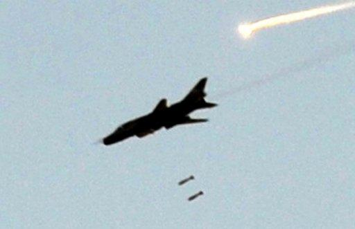 A Syrian army fighter jet bombs the town of Maaret al-Numan. Syrian warplanes launched air raids in Damascus province on Friday after overnight bombardments and clashes across the country, the Syrian Observatory for Human Rights watchdog said.