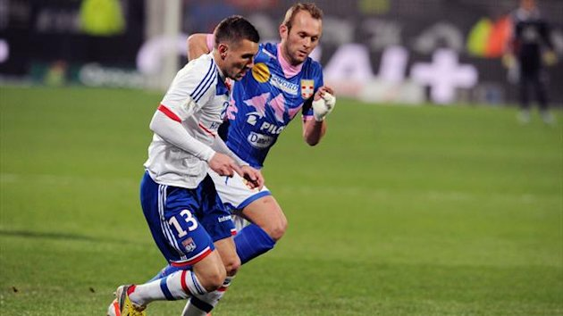 Lyon's French forward Anthony Reveillere (L) vies with Evian's French midfielder Olivier Sorlin