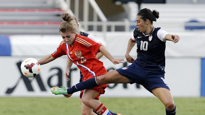 United States' Carli Lloyd (10) and Russia's Nelli Korovkina (20) battle for the ball during an international friendly soccer match in Boca Raton, Fla., Saturday, Feb. 8, 2014. The U.S. won 7-0