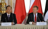 Chinese Prime Minister Wen Jiabao (L) and his Polish counterpart Donald Tusk take part in a meeting at the Royal Castle in Warsaw. Wen unveiled a total of $10.5 billion dollars in credit lines and funds aimed at boosting business with the blossoming economies of central and eastern Europe