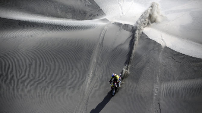 Chile's Claudio Rodriguez rides his Honda motorcycle during the second stage of the Dakar Rally 2013, from  Pisco to Pisco