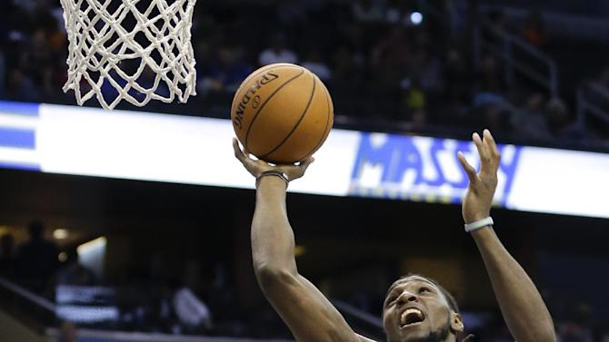 Denver Nuggets's Kenneth Faried (35) makes a shot over Orlando Magic's Tobias Harris (12) during the first half of an NBA basketball game in Orlando, Fla., Wednesday, March 12, 2014. Denver won 120-112