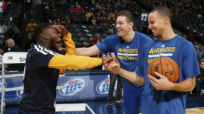 Denver Nuggets guard Nate Robinson, left, jokes with Golden State Warriors forward David Lee, back right, and guard Stephen Curry before an NBA basketball game in Denver, Monday, Dec. 23, 2013