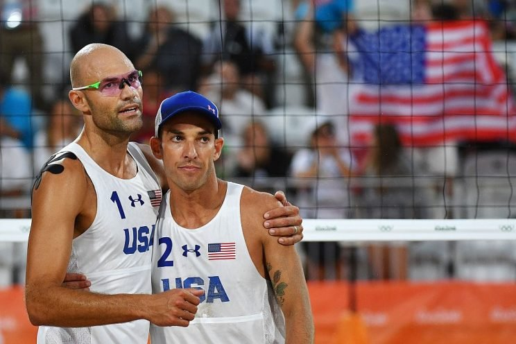USA's Phil Dalhausser (L) and Nicholas Lucena celebrate after winning the men's beach volleyball qualifying match between the USA and Tunisia at the Beach Volley Arena in Rio de Janeiro on August 7, 2016, for the Rio 2016 Olympic Games. / AFP / Leon NEAL (Photo credit should read LEON NEAL/AFP/Getty Images)