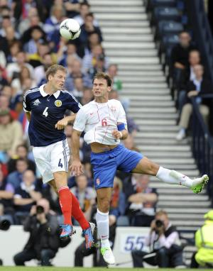 Christophe Berra, left, in action with Serbia's Branislav Ivanovic at Hampden