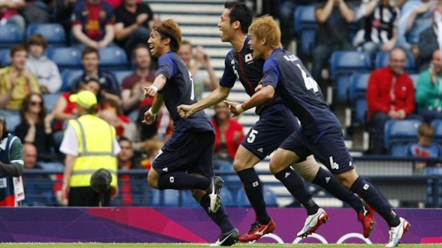 Japan's Yuki Otsu celebrates his shock winner against Spain