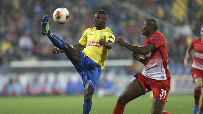 Estoril's Mano, left, clears the ball in front of Freiburg's  Karim Guede, from Slovakia, during their Europa League group H soccer match Thursday, Nov. 7 2013, in Estoril, Portugal