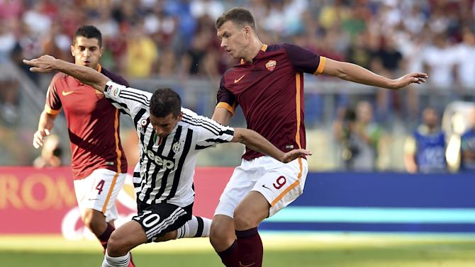 AS Roma's Dzeko and Juventus' Padoin fight for the ball during their Serie A soccer match at Olympic stadium in Rome