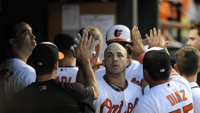 Orioles hit 4 HRs off Saunders, beat Rangers 7-1