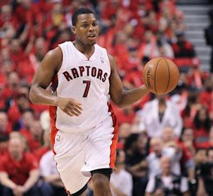 Lowry agrees to re-sign with Raptors