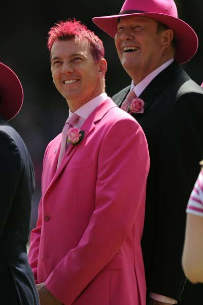 Australian cricketer Brett Lee (L) wears all pink during a promotional day to aid the McGrath Foundation which funds McGrath Breast Care Nurses in communities across Australia, on day three of the sec