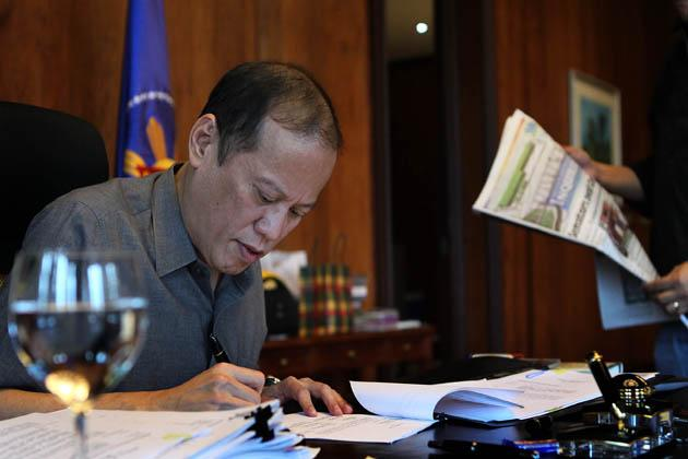President Benigno Simeon C. Aquino III goes over his papers in his office in Malacanang Palace as he admitted feeling better today, Thursday, March 15, 2012. Yesterday the President was not able to meet some of his visitors as he was not feeling well. (MPB/NPPA IMAGES)