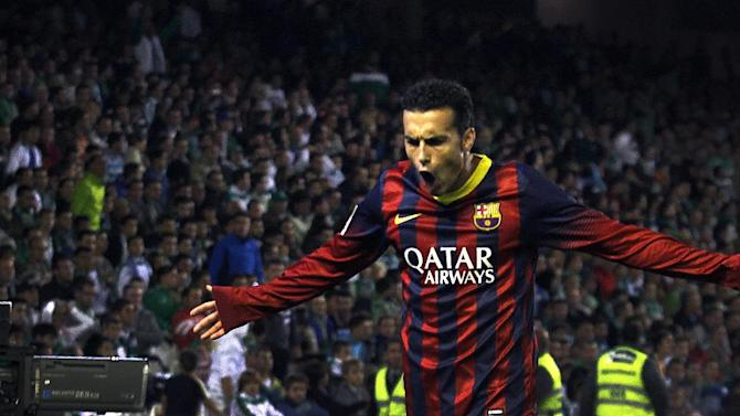 Barcelona's Pedro Rodriguez reacts after scoring against Betis during their La Liga soccer match at the Benito Villamarin stadium, in Seville, Spain on Sunday, Nov. 10, 2013