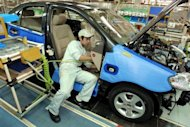 This file photo shows a worker installing parts to a Toyota vehicle at the Tianjin Toyota plant in 2002. The most significant wage hikes in 2010 and 2011 in China often came following strikes at Japanese companies such as Toyota and Honda and a wave of suicides at the factories of the Taiwanese electronics giant Foxconn