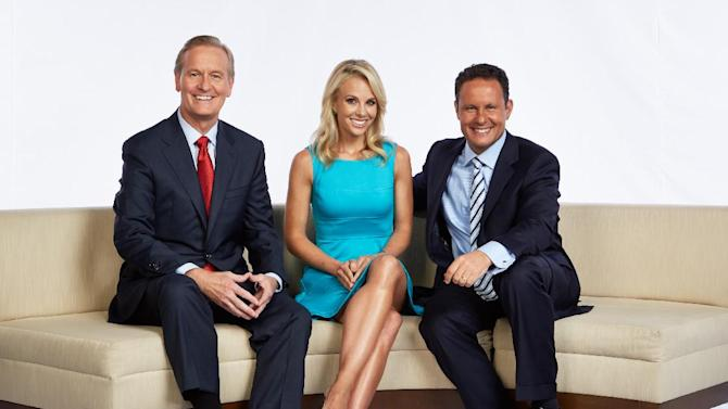 """This Aug. 2013 photo released by FOX News shows, from left, Steve Doocy, Elisabeth Hasselbeck and Brian Kilmeade in New York. Hasselbeck debuts as Doocy and Kilmeade's new partner on """"Fox & Friends"""" Monday, Sept 16, 2013. (AP Photo/FOX News)"""