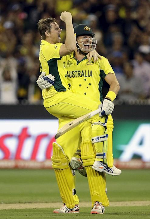 Australia's Steven Smith jumps on team mate Shane Watson after he hit the winning runs to defeat New Zealand in their Cricket World Cup final match at the MCG