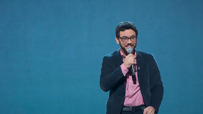 """This publicity image released by Comedy Central shows Al Madrigal from """"The Daily Show with Jon Stewart,"""" during the taping of his comedy special, """"Why is the Rabbit Crying,"""" airing Friday, April 26, 2013 at 11 p.m. on Comedy Central. (AP Photo/Comedy Central, Cliff Cheney)"""