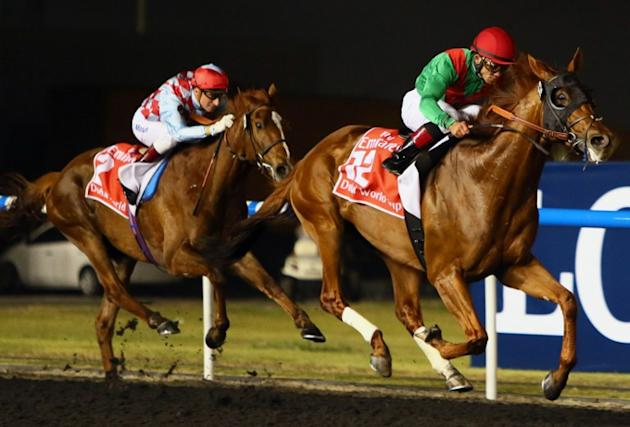 Joel Rosario (R) on Animal Kingdom competes before winning the $10 million Dubai World Cup, the world's richest race, at Meydan race track in Dubai on March 30, 2013. The 2011 Kentucky Derby winner (1
