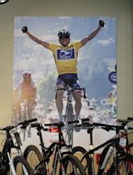 A poster of cyclist Lance Armstrong adorns a wall at Mellow Johnny's bike shop, pictured on October 18, in Austin, Texas. Armstrong on Friday shook off the cloud of doping allegations dogging him as he urged backers of his Livestrong charity to continue the fight against cancer
