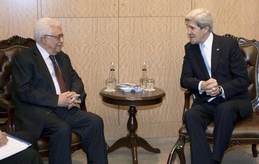 US Secretary of State John Kerry (R) speaks with Palestinian President Mahmoud Abbas on April 21, 2013, in Istanbul. The Hamas rulers of Gaza on Sunday slammed US Secretary of State John Kerry for urging the Turkish prime minister to delay a visit to the Palestinian territory