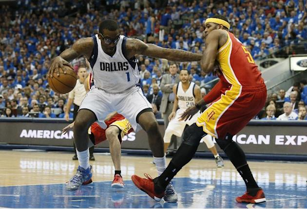 Dallas Mavericks' Amar'e Stoudemire fights for a shot opportunity against Houston Rockets' Josh Smith during Game 4 in an NBA basketball first-round playoff series Sunday April 26, 2015, i