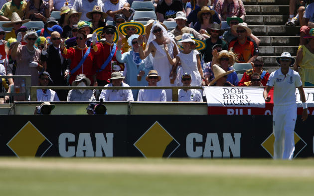England's fans dressed like the Royal Family indicate four runs near England's Broad during the second day of the third Ashes test cricket match against Australia in Perth