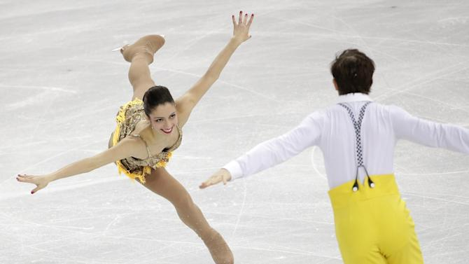 Stefania Berton and Ondrej Hotarek of Italy compete in the pairs short program figure skating competition at the Iceberg Skating Palace during the 2014 Winter Olympics, Tuesday, Feb. 11, 2014, in Sochi, Russia