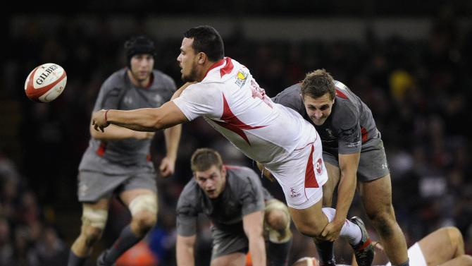 Wales' Ashley Beck tackles Tonga's Suliasi Taufalele during their international rugby union match in Cardiff