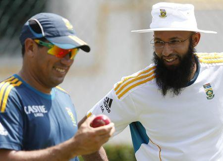 South Africa's captain Amla talks with team coach Domingo during a practice session ahead of their second test cricket match against Sri Lanka in Colombo