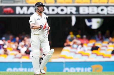 New Zealand captain Brendon McCullum walks from the Gabba after Australian bowler Mitchell Marsh claimed the wicket, during the first cricket test match between Australia