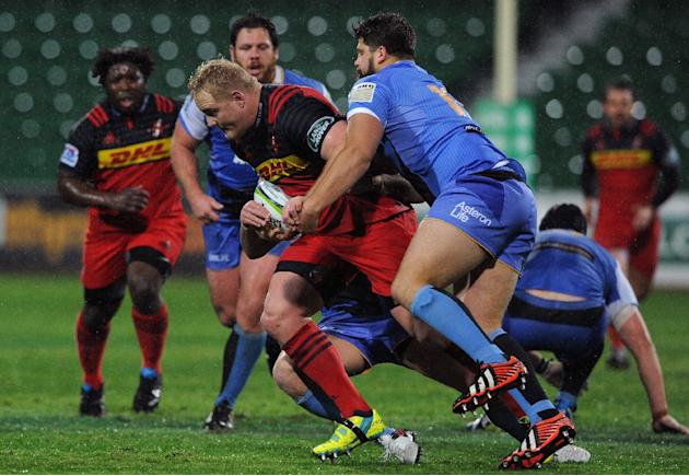 Stormers Vincent Koch (C) attempts to break a tackle during the Super Rugby match between Australia's Western Force and South Africa's Stormers in Perth on July 9, 2016