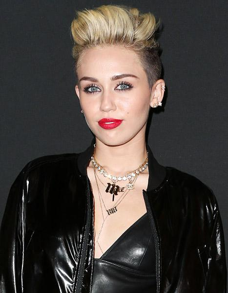 "Miley Cyrus Talks Liam Hemsworth, Says Alcohol Is ""Way More Dangerous"" Than Weed"