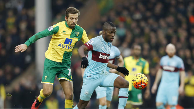 West Ham's Enner Valencia in action with Norwich City's Gary O'Neil
