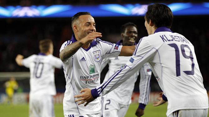 Anderlecht's Demy De Zeeuw, left, celebrates his opening goal with Sacha Kljestan during their Champions League group C soccer match against Paris Saint Germain in Paris, France, Tuesday, Oct. 5, 2013