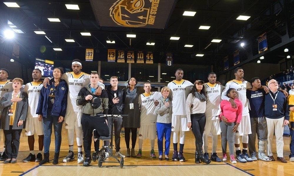 Kent State players each invited a fan to stand with them during Wednesday's national anthem (via Kent State Athletics)