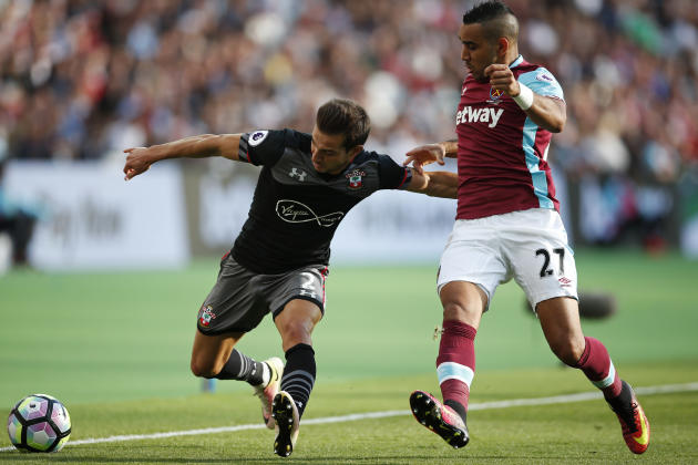 Southampton's Cedric Soares in action with West Ham United's Dimitri Payet