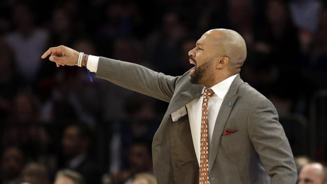 New York Knicks head coach Derek Fisher talks to his players during the second half of the NBA basketball game against the Denver Nuggets, Sunday, Feb. 7, 2016, in New York. The Nuggets defeated the Knicks 101-96. (AP Photo/Seth Wenig)
