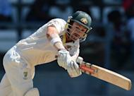 Australian batsman Ed Cowan plays a shot during the third day of the third Test match against the West Indies in April. Cowan goes into the first Test under pressure to hold on to his Test spot with top-order batsman Rob Quiney to make his Test debut for injured allrounder Shane Watson