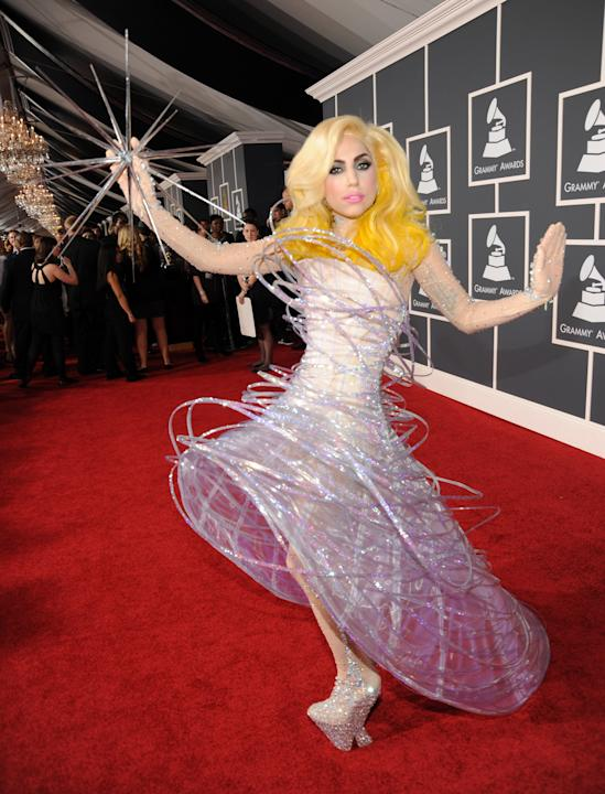 Lady Gaga at the 2010 GRAMMYs is what this whole business is all about: the glittering, fantastically bizarre Armani confection, constructed to look as if it was actually orbiting the singer's body, a