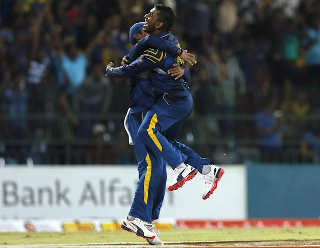 Sri Lanka's Jayasuriya celebrates with his teammate Vandersay after taking the wicket of Pakistan's captain Afridi during their second Twenty20 cricket match in Colombo